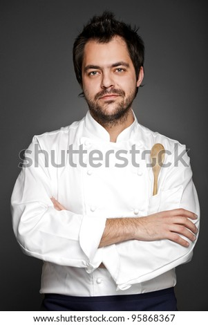 Handsome chef posing with hands crossed