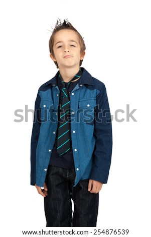 Handsome child doing different expressions in different sets of clothes: bored - stock photo
