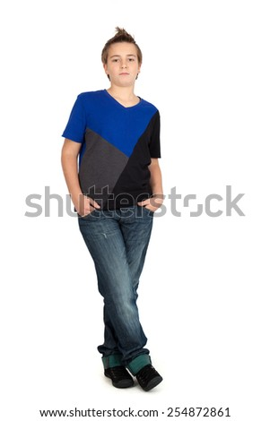 Handsome child doing different expressions in different sets of clothes: full length hands in pockets - stock photo