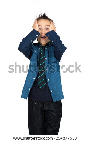 Handsome child doing different expressions in different sets of clothes: headache - stock photo
