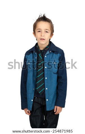 Handsome child doing different expressions in different sets of clothes: surprise - stock photo