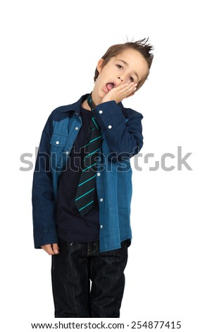 Handsome child doing different expressions in different sets of clothes: toothache - stock photo