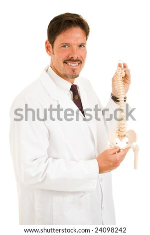 Handsome chiropractor holding up a scale model of the human spine.  Isolated on white. - stock photo