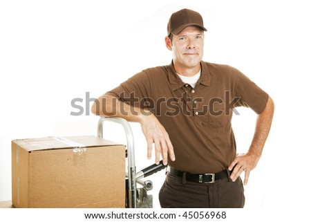 Handsome, confident delivery man or mover leaning on his dolly.  Isolated on white. - stock photo