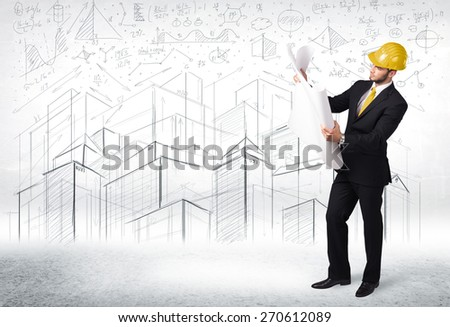 Handsome construction specialist with city drawing in background concept - stock photo