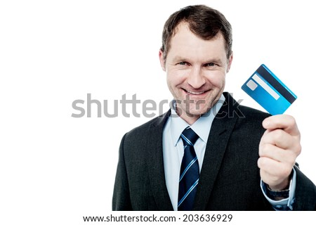 Handsome corporate man showing his credit card - stock photo