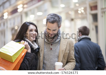handsome couple doing shopping city lights in the background - stock photo