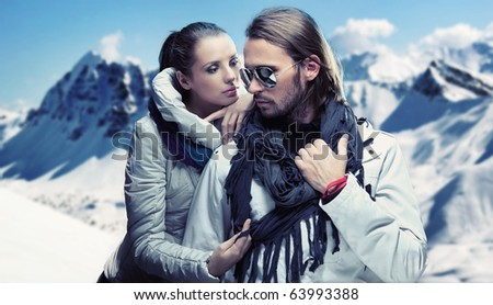 Handsome couple having fun on winter holidays - stock photo