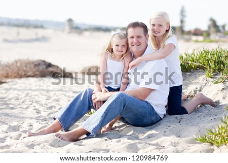 Handsome Dad and His Cute Daughters Portrait at The Beach