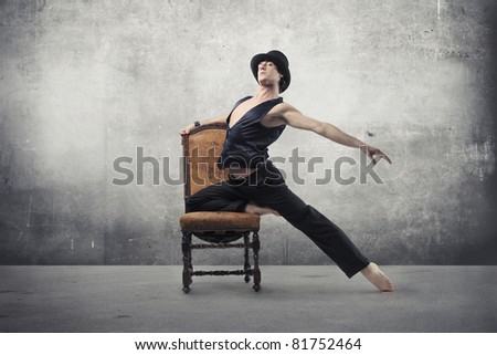 Handsome dancer on a chair - stock photo