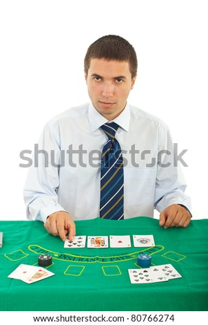 Handsome dealer man at casino table isolated on white background