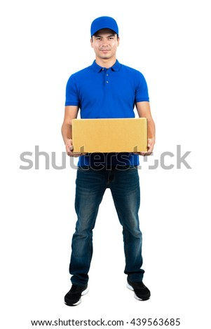 Handsome delivery man holding parcel box - full body, isolated on white background - stock photo