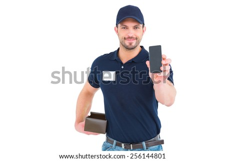 Handsome delivery man showing mobile phone on white background - stock photo