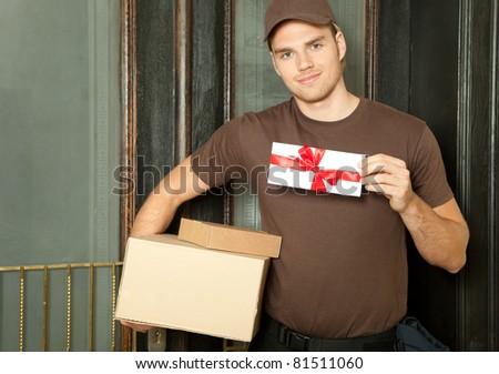 handsome deliveryman - stock photo