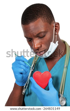 Handsome doctor cardiologist holding a red heart - stock photo