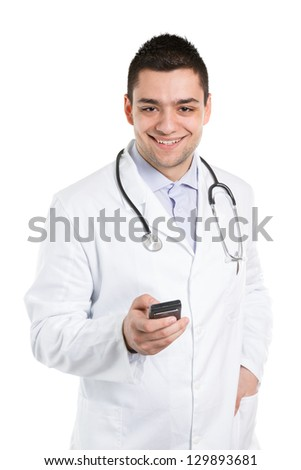 Handsome doctor holding cell phone in a hand.