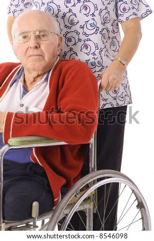 handsome elderly man in wheelchair with nurse - stock photo
