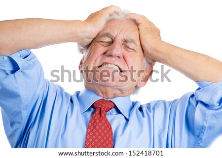 Handsome elderly man with white hair in blue shirt and red tie, stressed and frustrated with raging headache isolated over white background - stock photo