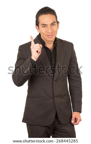 handsome elegant young latin man wearing a suit posing pointing up isolated on white - stock photo