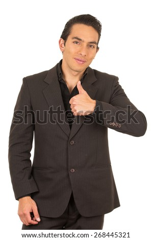 handsome elegant young latin man wearing a suit posing with thumb up isolated on white - stock photo