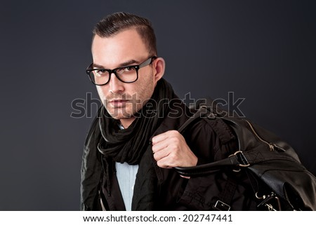 handsome elegant young man with bag - stock photo