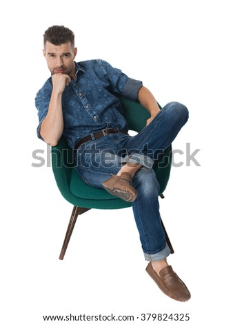 Handsome emotional Man sitting in armchair Portrait Isolated on White Background - stock photo