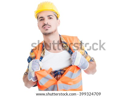 Handsome engineer acting like a super hero in his workwear while holding his shirt and vest isolated on white background - stock photo