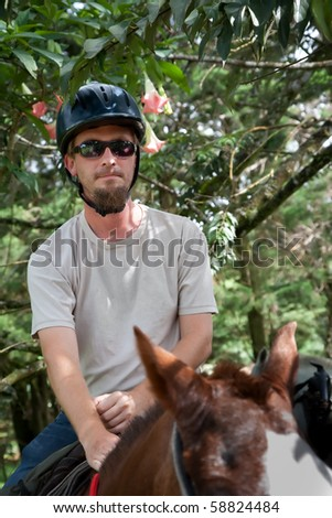 Handsome European or American man on horseback in Costa Rica