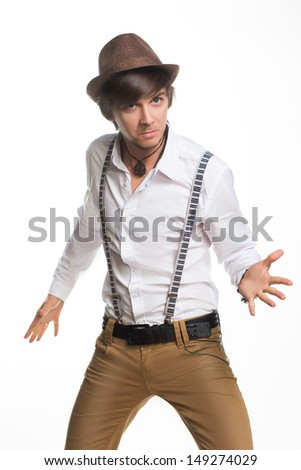 handsome excited man happy smile looking at camera, hold arm hands fist raised up gesture, young guy wear shirt, isolated over white background