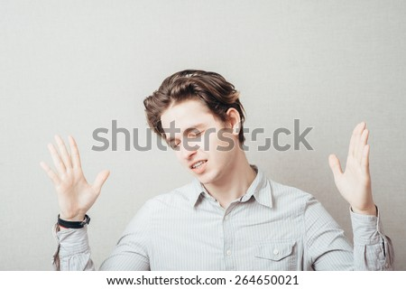handsome excited man happy smile, raised hands arms palms, young guy casual wear, full length - stock photo
