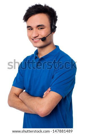 Handsome executive assisting client over a call - stock photo