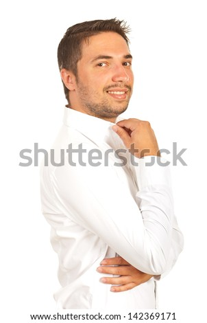 Handsome executive male holding hand to collar shirt isolated on hwite background