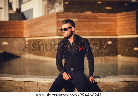 handsome fashion male model. copy space. portrait of a young guy in the city - stock photo