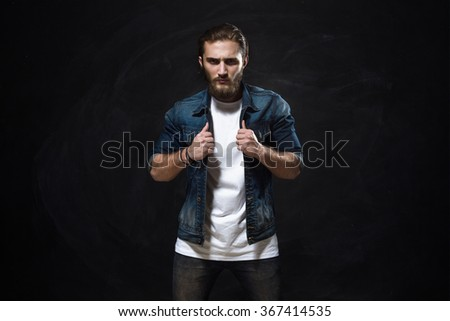 Handsome Fashion Man In Jeans Jacket Posing On Gray Background - stock photo