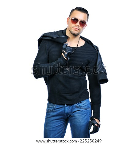 Handsome fashion man wearing jacket and sunglassses - stock photo