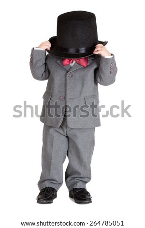 Handsome fashionable child in retro style with  suit and bowler on shoulders - stock photo