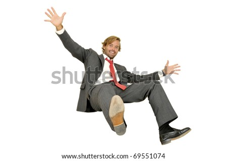 Handsome fashionable man jumping isolated in white - stock photo