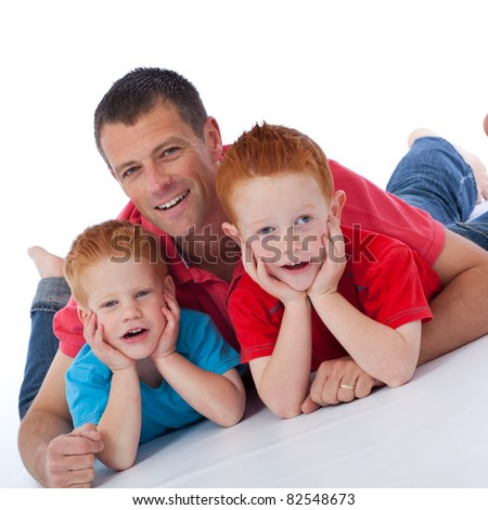 Handsome father with his happy playful sons - stock photo