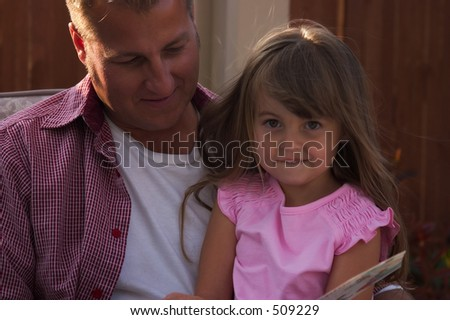 handsome father with his pretty little girl