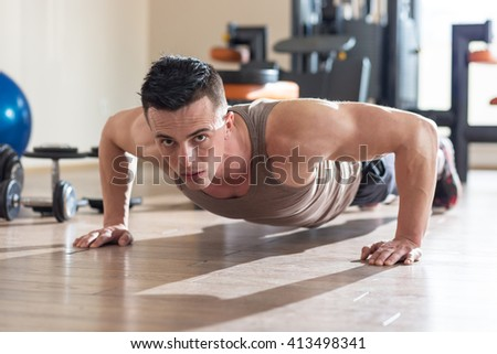 Handsome fit man exercising a the gym - stock photo