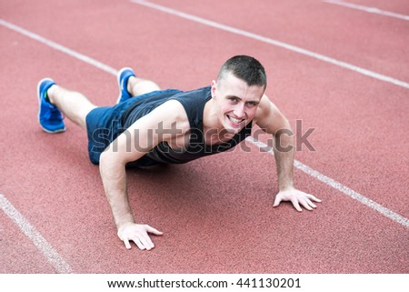 Handsome fit man exercising push up