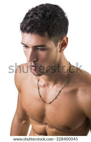 Handsome, fit shirtless young man isolated on white background, shot from above, looking away - stock photo