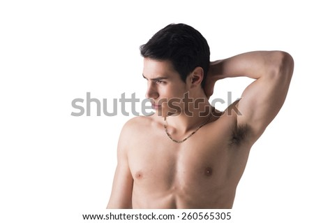 Handsome, fit young man standing shirtless isolated on white, hand behind his head, looking away - stock photo