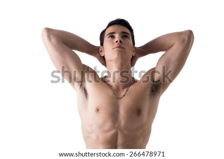 Handsome, fit young man standing shirtless isolated on white, hands behind his head, looking up - stock photo