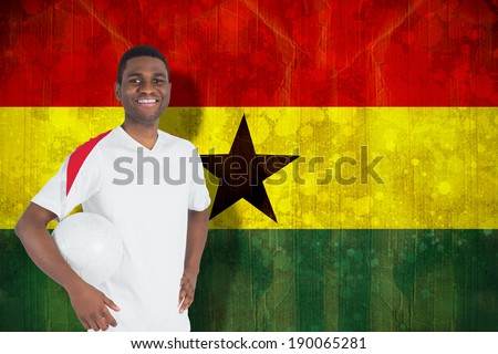 Handsome football fan looking at camera against ghana flag in grunge effect - stock photo
