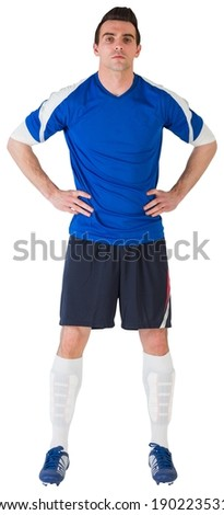 Handsome football player in blue jersey on white background - stock photo