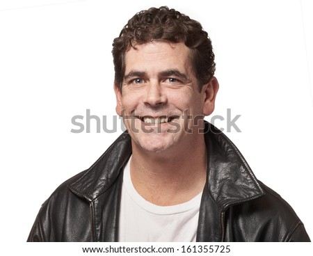 Handsome friendly man in black leather jacket isolated on white - stock photo