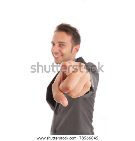 Handsome funny businessman pointing at you - stock photo