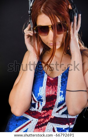 handsome girl listening the music - stock photo