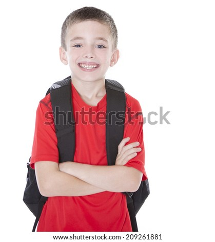 Handsome gradeschooler with backpack isolated on white background - stock photo